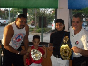 yong-champions-with-belts-and-trainers-at-hurricane-boxing-gym